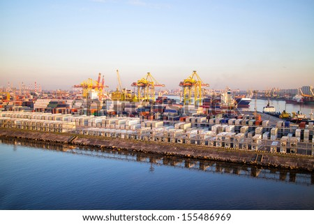Sea port. Unloading of containers - stock photo