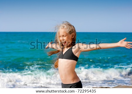 Sea portrait girl in sport swimming suit