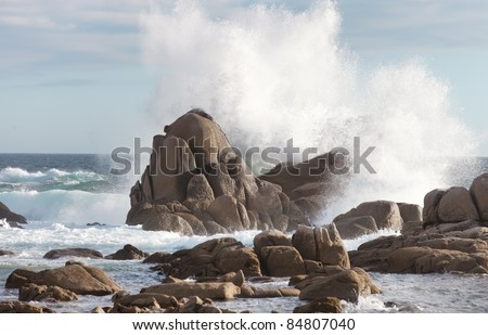 sea rock is breaking powerful wave - stock photo