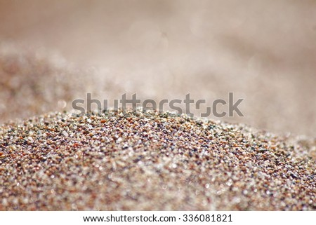 Sea run-multicolored sand on the beach close-up. - stock photo