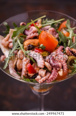Sea salad in a glass. - stock photo