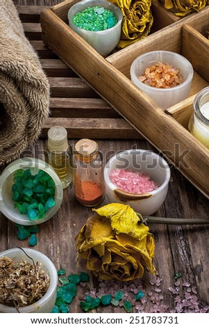 sea salt and accessories for rejuvenating spa sessions - stock photo