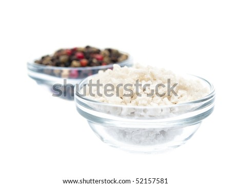 Sea salt and pepper in glass bowls isolated on pure white background - stock photo