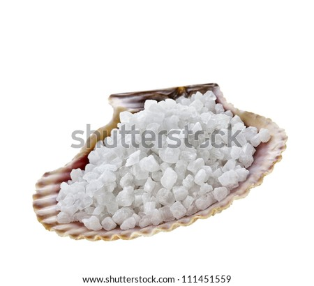 sea salt crystals in the sea shell Isolated on white - stock photo
