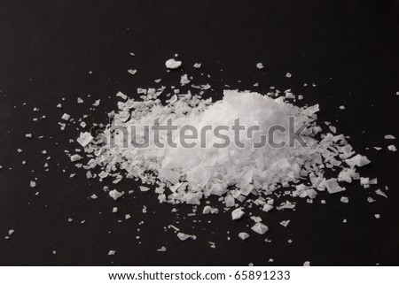 Sea salt from Portugal on black background - stock photo