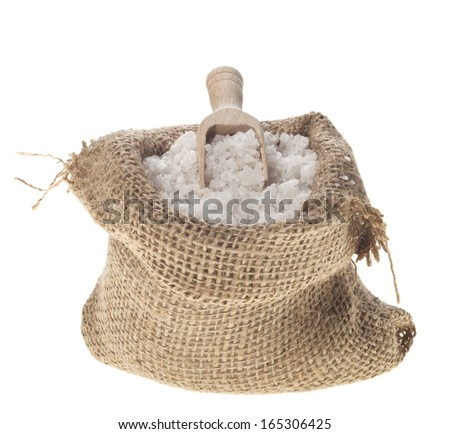 Sea salt in a jute sack on a white background. - stock photo