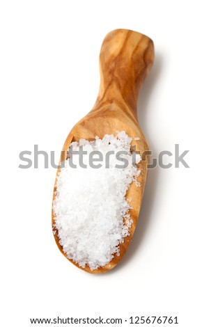 sea salt in a scoop isolated on white background - stock photo