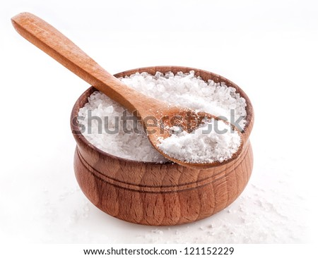 Sea Salt in a spoon and bowl on white background - stock photo