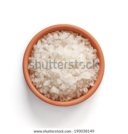 Sea salt in bowl on white background with clipping path - stock photo