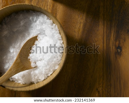 Sea Salt in bowl with copy space - stock photo
