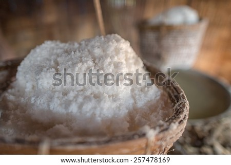 Sea salt in the bamboo basket  on salt farm. - stock photo