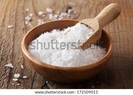 sea salt in wooden bowl and scoop  - stock photo