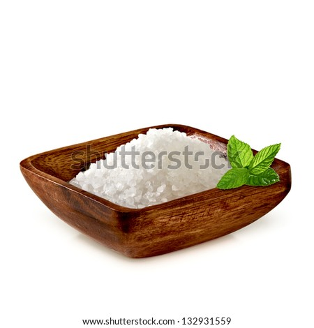 Sea salt in wooden plate with fresh mint on white background - stock photo