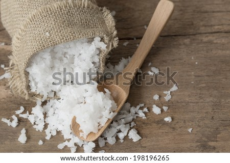 Sea salt in wooden spoon - stock photo