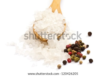 Sea salt in wooden spoon and mixed pepper isolated on white background - stock photo