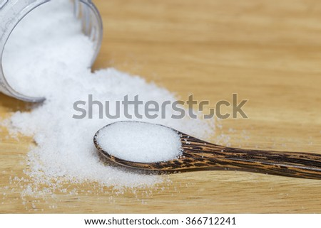Sea Salt In Wooden Spoon on table wood - stock photo