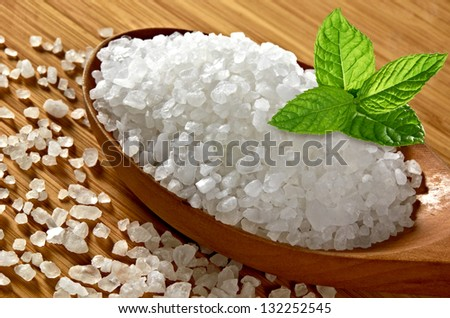 Sea Salt In Wooden Spoon With Fresh Mint - stock photo