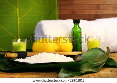Sea salt, lemons and leaves spa session - stock photo