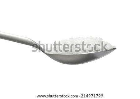 Sea Salt on spoon - stock photo