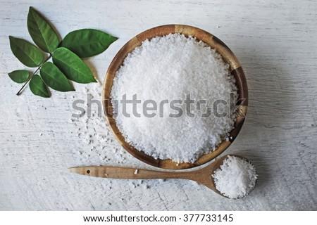 sea salt on wooden background - stock photo