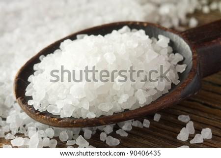 Sea salt on wooden spoon - stock photo