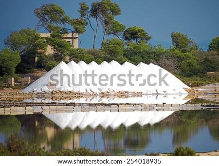 Sea salt production. Heap of sea salt. - stock photo