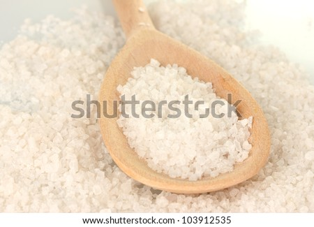 Sea salt with wooden spoon close-up