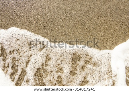 sea sand and rocks with wave - stock photo