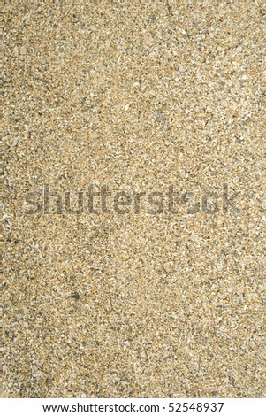 Sea sand with remnants of shells and small pebbles. Background - stock photo