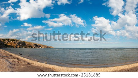 Sea sandy coastline with cape (Ukraine, Crimea)