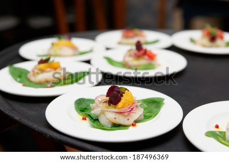 Sea scallop carpaccio dishes ready for serving - stock photo