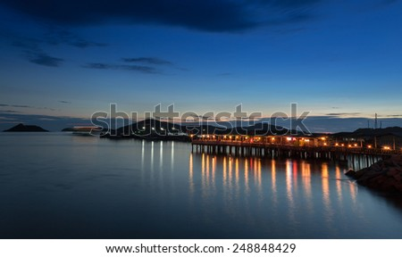 Sea scape with wood terrace in twilight time - stock photo