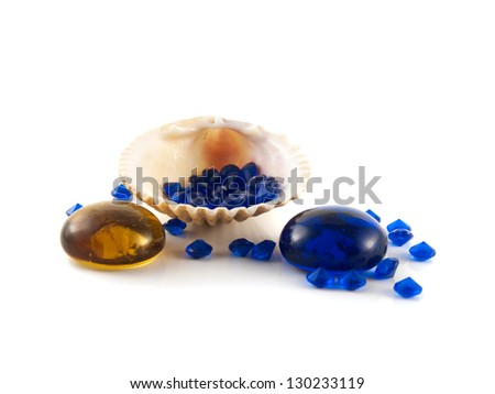 Sea shell isolated on white background with blue crystals, stones (decorative diamonds). Decorative composition. - stock photo