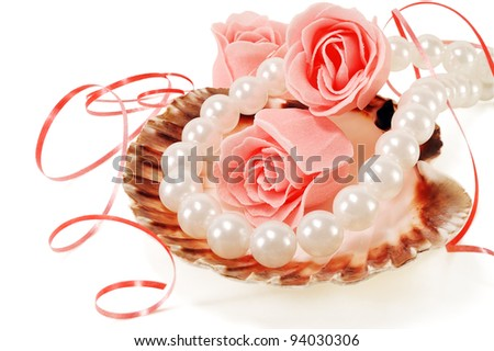 sea shell with pearls and a rose on a white background - stock photo