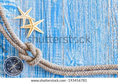 Sea shells and marine rope - stock photo