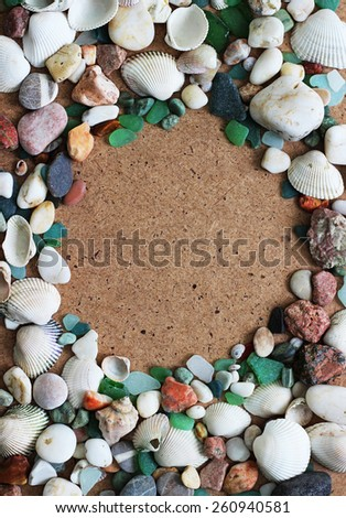 sea shells and stones frame. your text here - stock photo