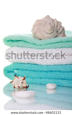 Sea shells and towels with  reflection - stock photo