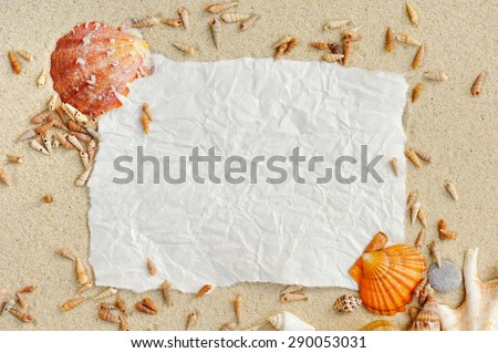 Sea shells, vintage paper with sand as background - stock photo