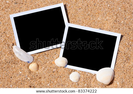 Sea shells with photos on sand background. Traveling to the sea concept. - stock photo