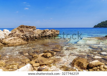 Sea shore and stones close background in Greece