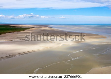 Sea shore in Normandy during low tide, France - stock photo