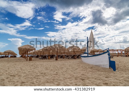 Sea shore with parasols in summer  - stock photo