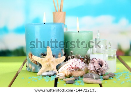 Sea spa composition on wooden table on blue natural background - stock photo