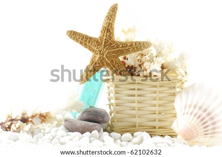 Sea spa elements with white pebbles and starfish and sea shells - stock photo