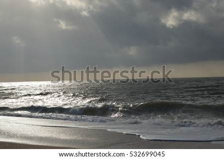 Sea Splashing Ocean Waves with Light Brown Sand Beach