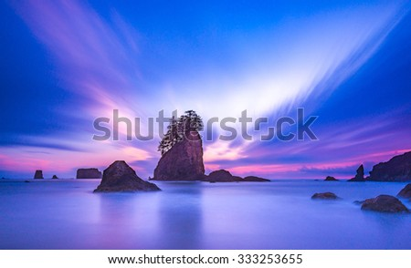 sea stack in sunset time with blue and purple light,scenic view of second beach in mt Olympic National park,Washington,USA. - stock photo