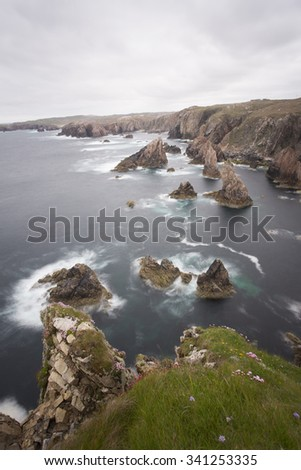 sea stacks on the rugged coastline of scotland - stock photo