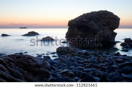 Sea stones during sunrise - stock photo