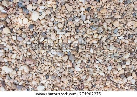 Sea stones laid out in the form of a circle,background texture - stock photo