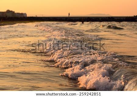 sea sun set beach wave - stock photo